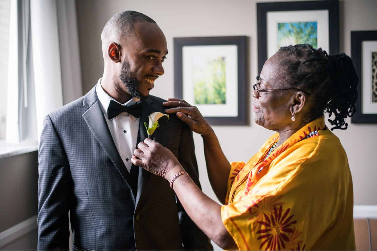 A groom with his mother before the wedding