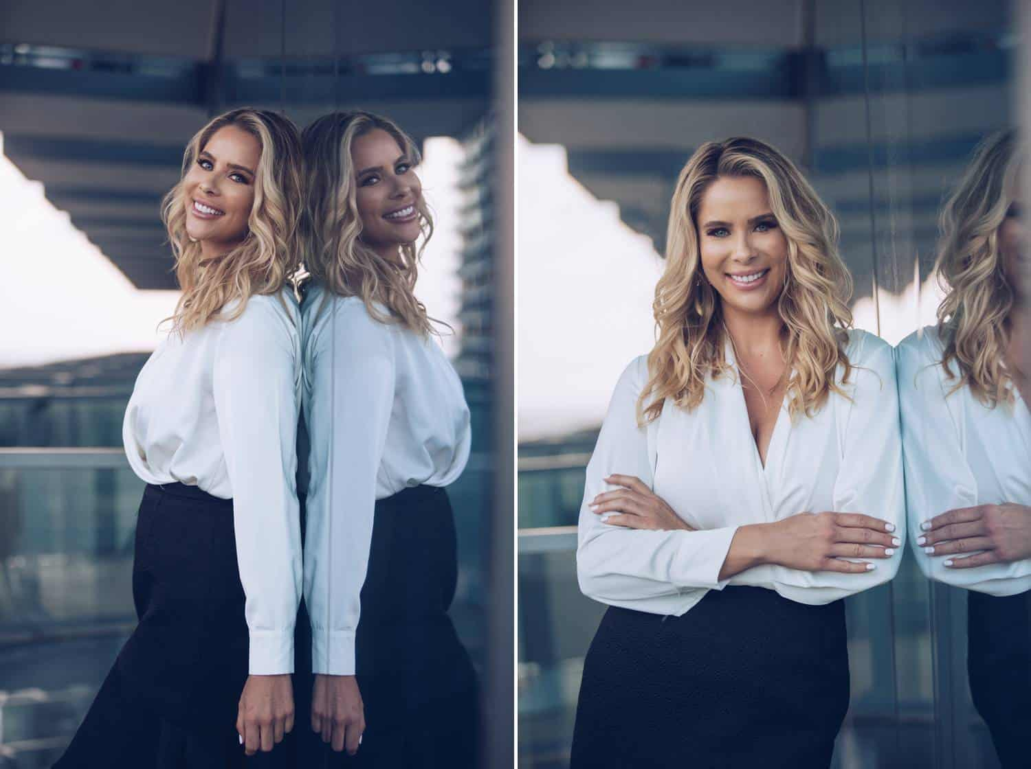 Two portraits by Lauren Alexis Rodriguez are shown side-by-side. On the left, a blonde woman wears a white shirt and black pencil skirt as she leans against a reflective window and looks over her shoulder. In the second photo, the same woman in the same outfit leans her arm against the same window.