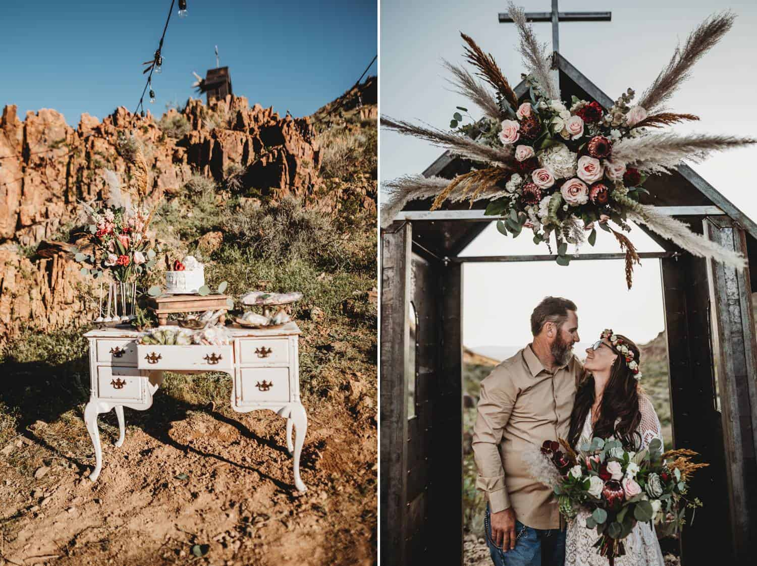 Two photographs from a desert wedding. In one, a white vintage dresser is decorated with flowers and a wedding cake, all set against the backdrop of the red mountains. In the next photo, a casually-dressed groom embraces his white-gowned bride as they stand under a tiny outdoor chapel that is decorated with flowers and a cross.