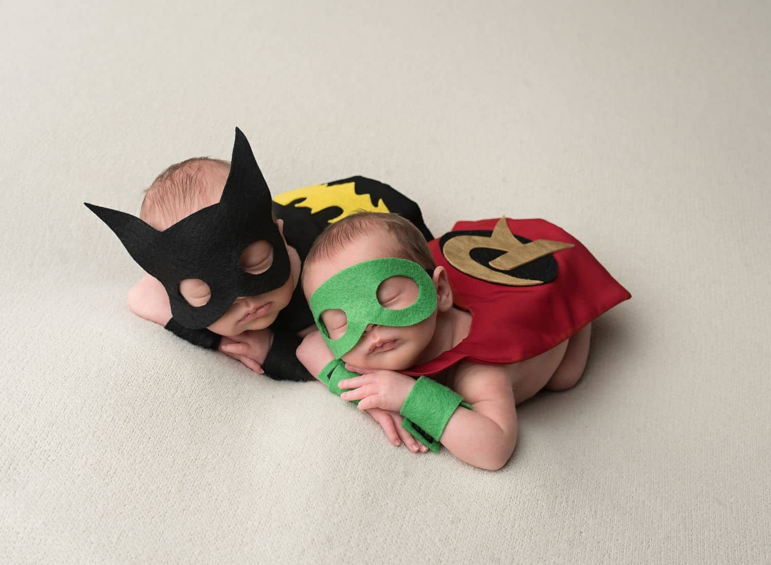 Two of the best newborn photograph props are these felt masks and miniature caps depicting newborn twins as Batman and Robin!