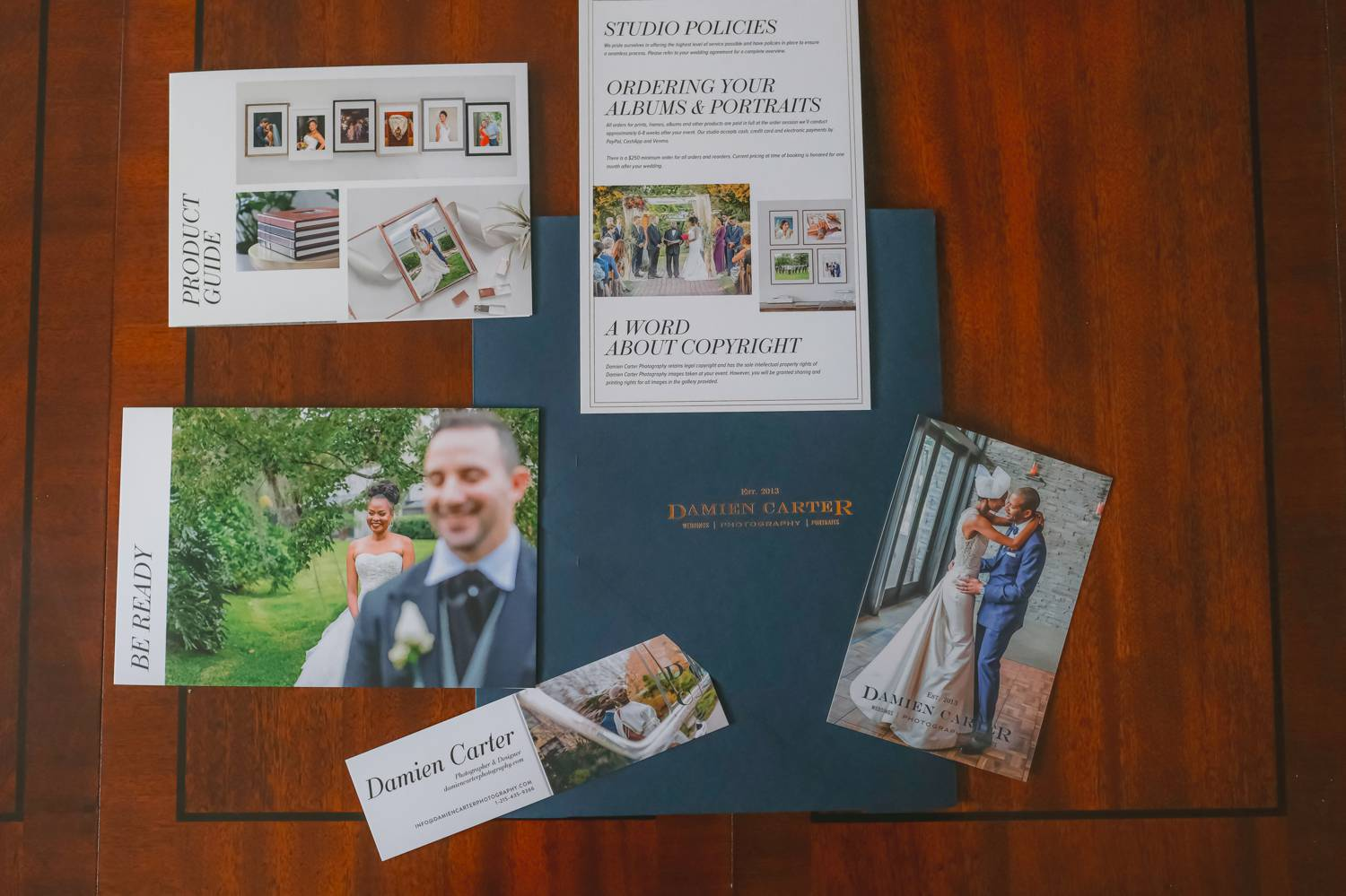 Samples of photographer Damien Carter's welcome packet that he gives to each of his new clients